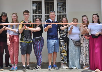 Cutting the ribbon on the Boys Dorm