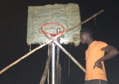 Working at night on the basketball posts